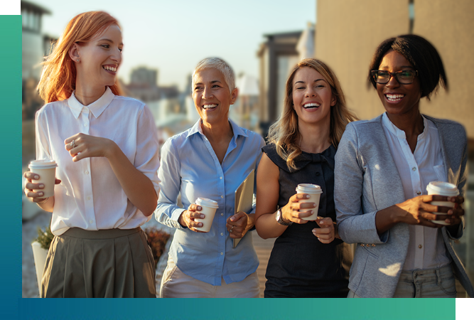 Group of happy women walking, and holding paper coffee cups